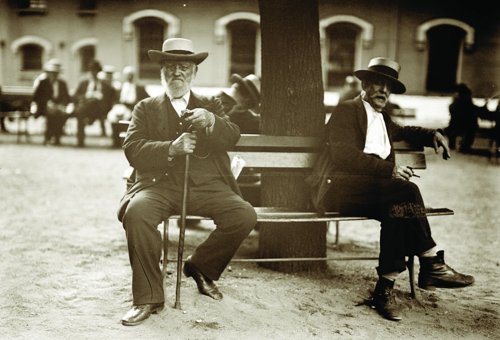 Two resident sailors relax on a bench, likely on Chapel Road, circa 1915. PHOTO: LOC