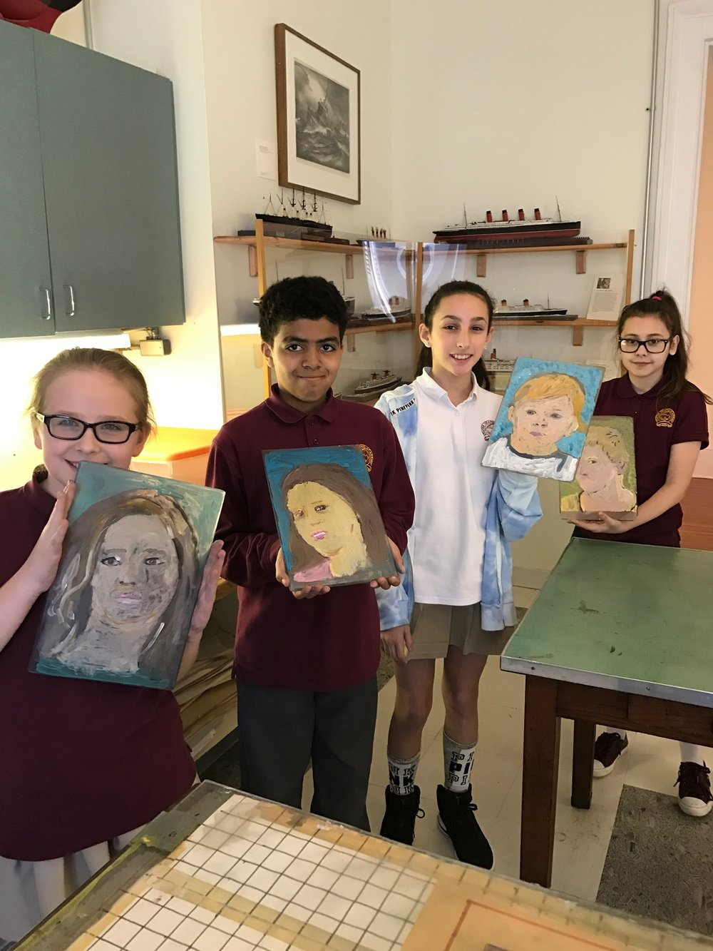 Staten Island Academy sixth grade students created portraits in the museum's printmaking studio.  Here they are displaying the monoprint plates they painted while waiting to transfer them to paper on our intaglio press.  PHOTO: Dawn Daniels