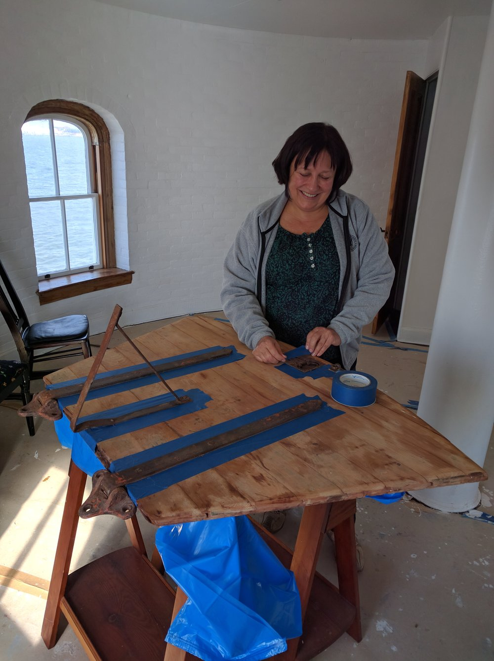 Leslie working on the Watch Gallery hatch cover.