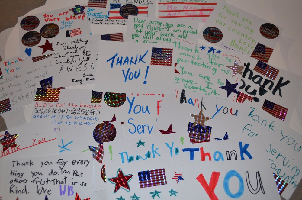 Making thank you cards for servicemen and women.