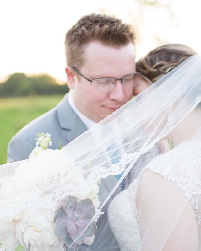 I absolutely love long veils! Not only are they elegant, classic and beautiful, they also allow some pretty amazing shots on your wedding day! Just look at this sweet moment between Chris and Erica!