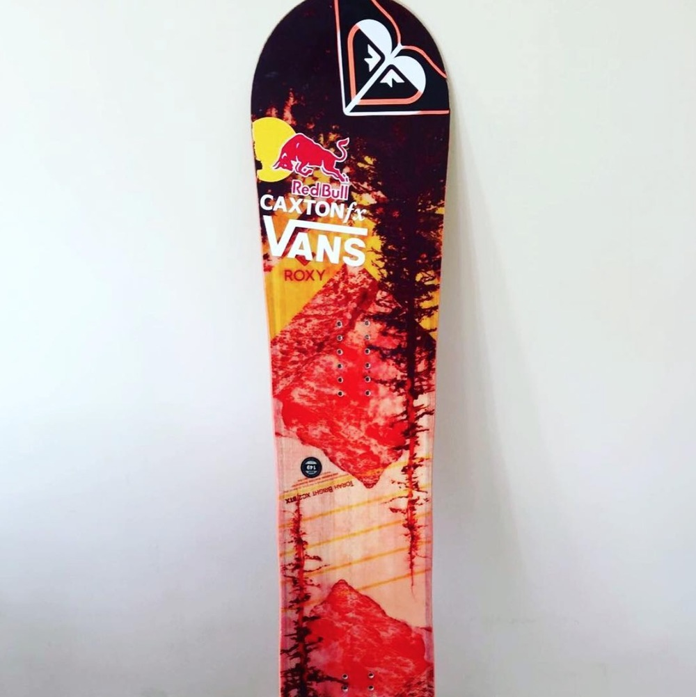 The Snowboard up for grabs. SHE IS well used! and ready for a new home.Get raffling. She could be yours :)