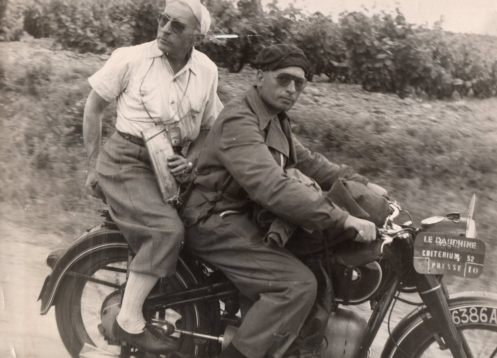 French radio reporter and bon vivant Alex Virot and his driver René Wagner during the 1952 Critérium du Dauphiné