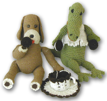 Hi! It's me bunny! On the RIght. i'm the alligator! That's buddy on the left.  We like to eat cookies! BUDDY! get your hand out of the cookie jar!!!