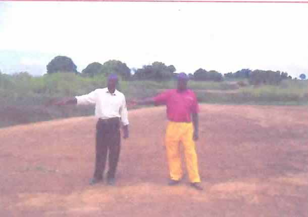 Pastor and colleague at building site
