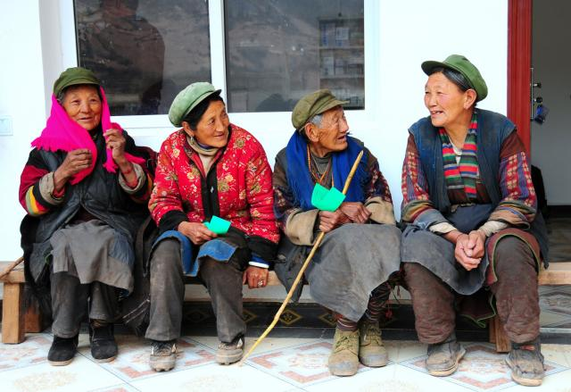 Local villagers waiting to be seen at clinic