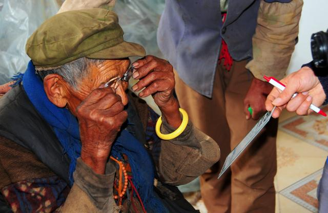 Local elderly lady receiving much needed eye glasses