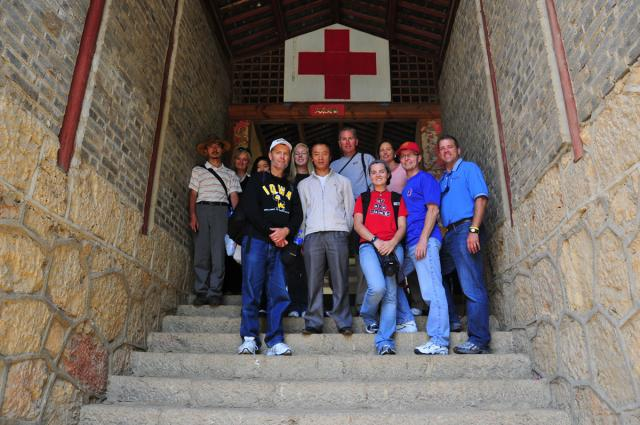 2010 group on the steps leading into clinic