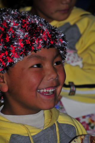 Each child received a new handmade stocking cap