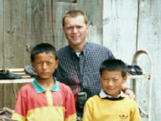 Scott with village children