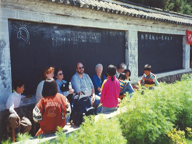 Group with children at LiJiang Orphanage