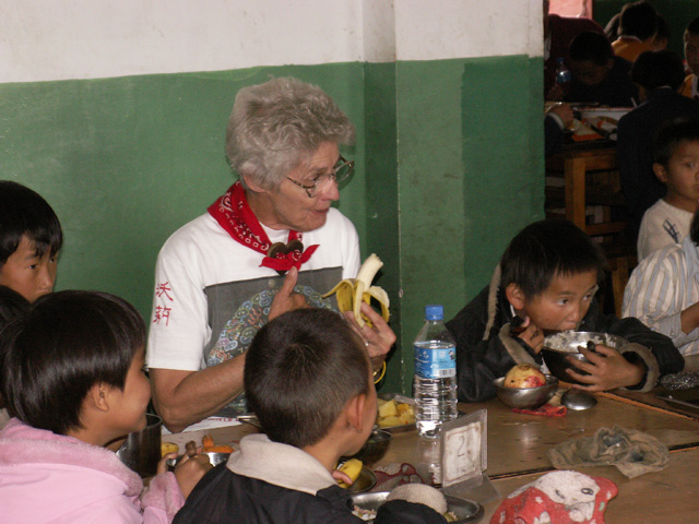 Marilyn eating lunch at orphanage in Lijiang