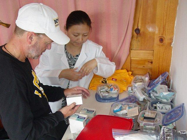 Scott delivering dental equipment to Ren Li Clinic