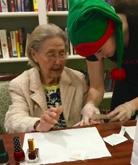 GG volunteer Jackie files a senior's nails.