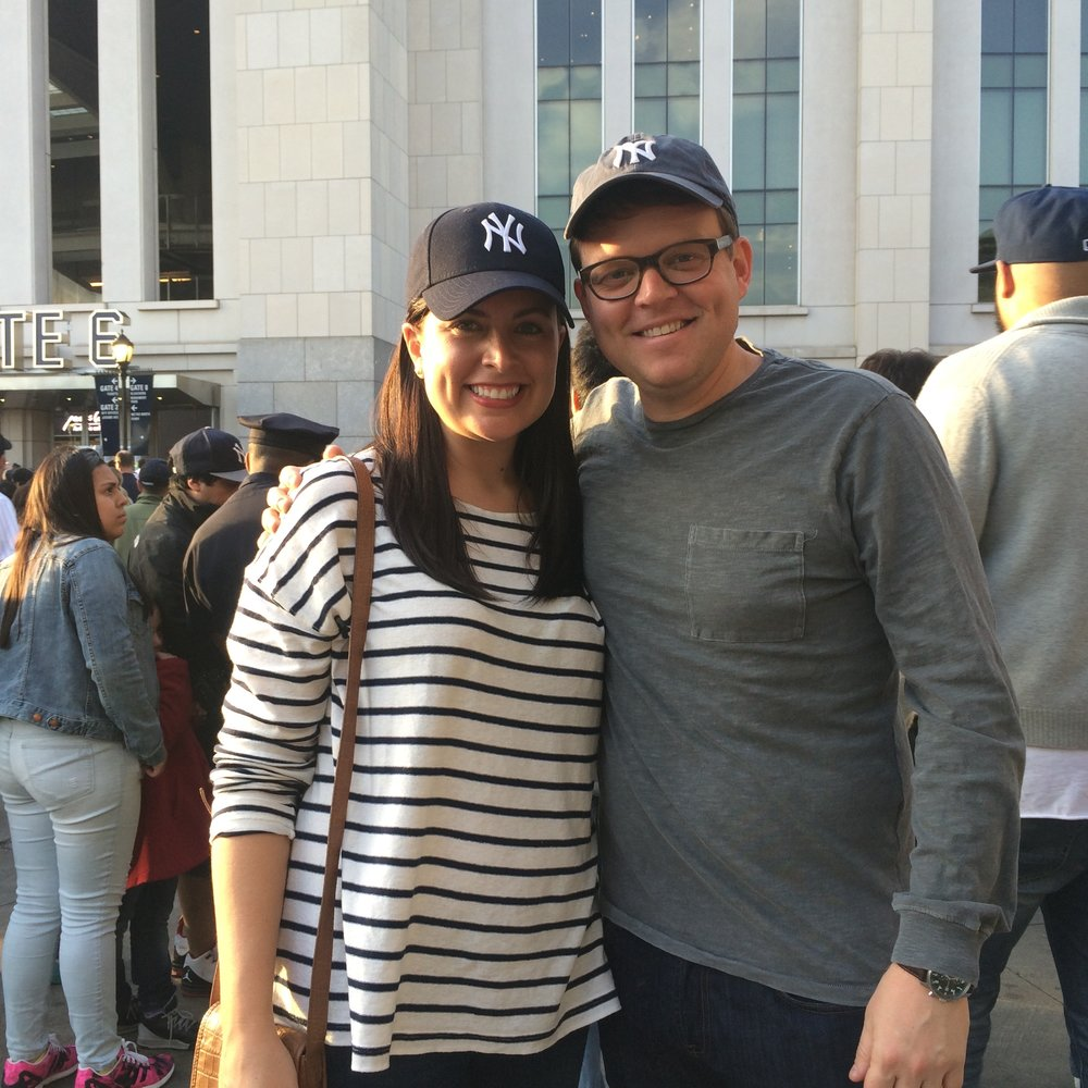At a Yankees game with her husband, JC, this past spring.