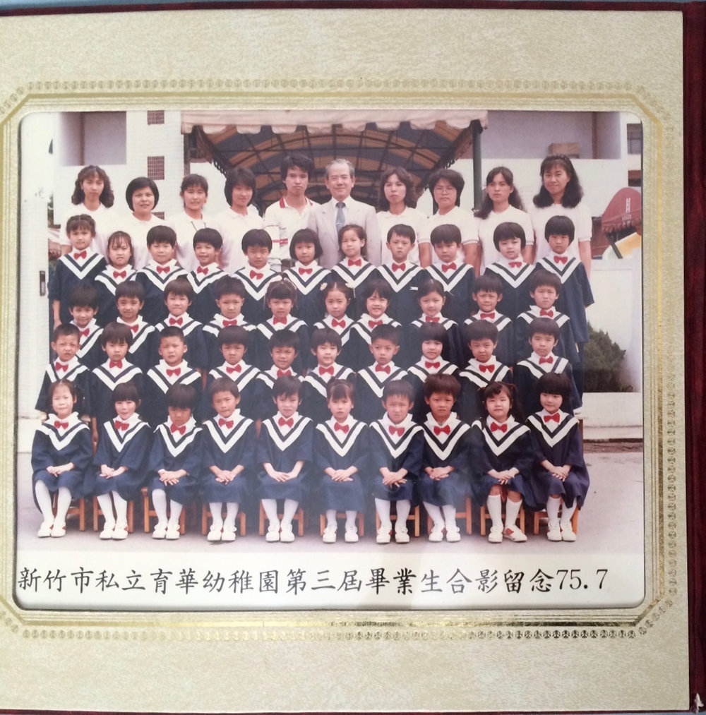 Carolyn at age 6 in 1st grade (she's in the top row, at the far right end) with classmates in Taiwan in 1985.