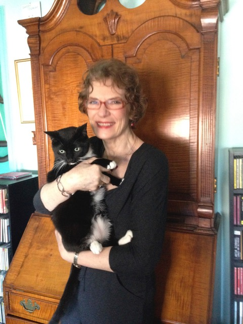 "Caroline with her cat Bruce, ""the love of my life. We have a delightfully contentious relationship."""
