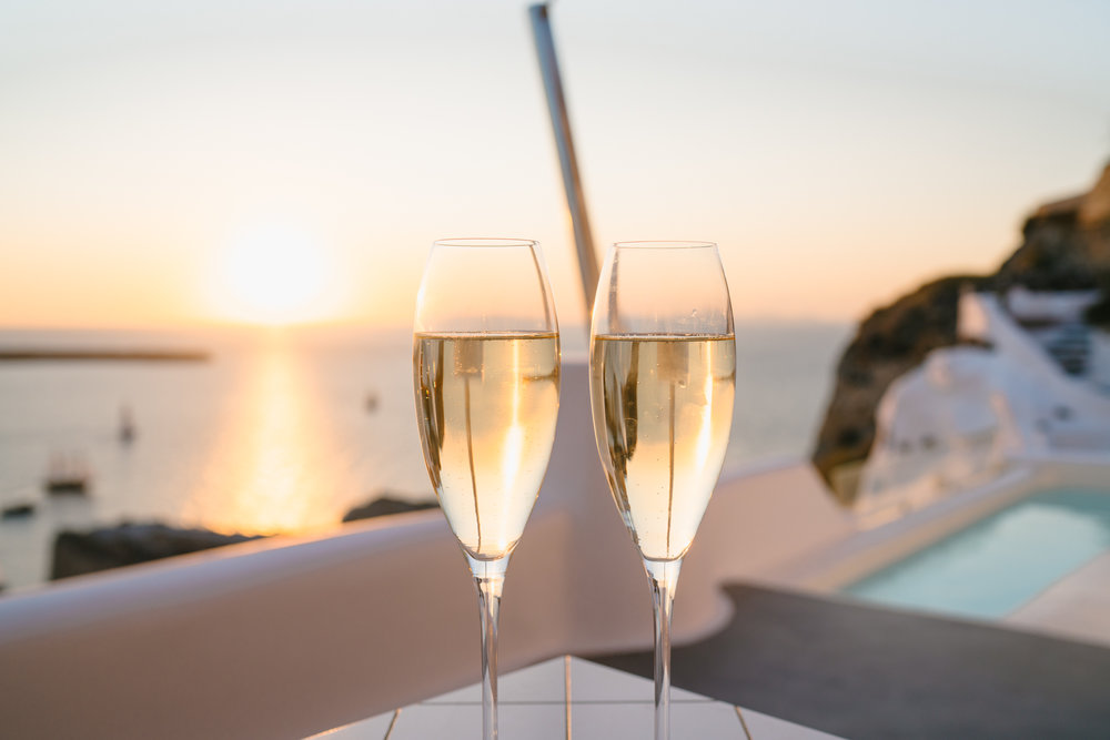 Sunset champagne toast in Santorini