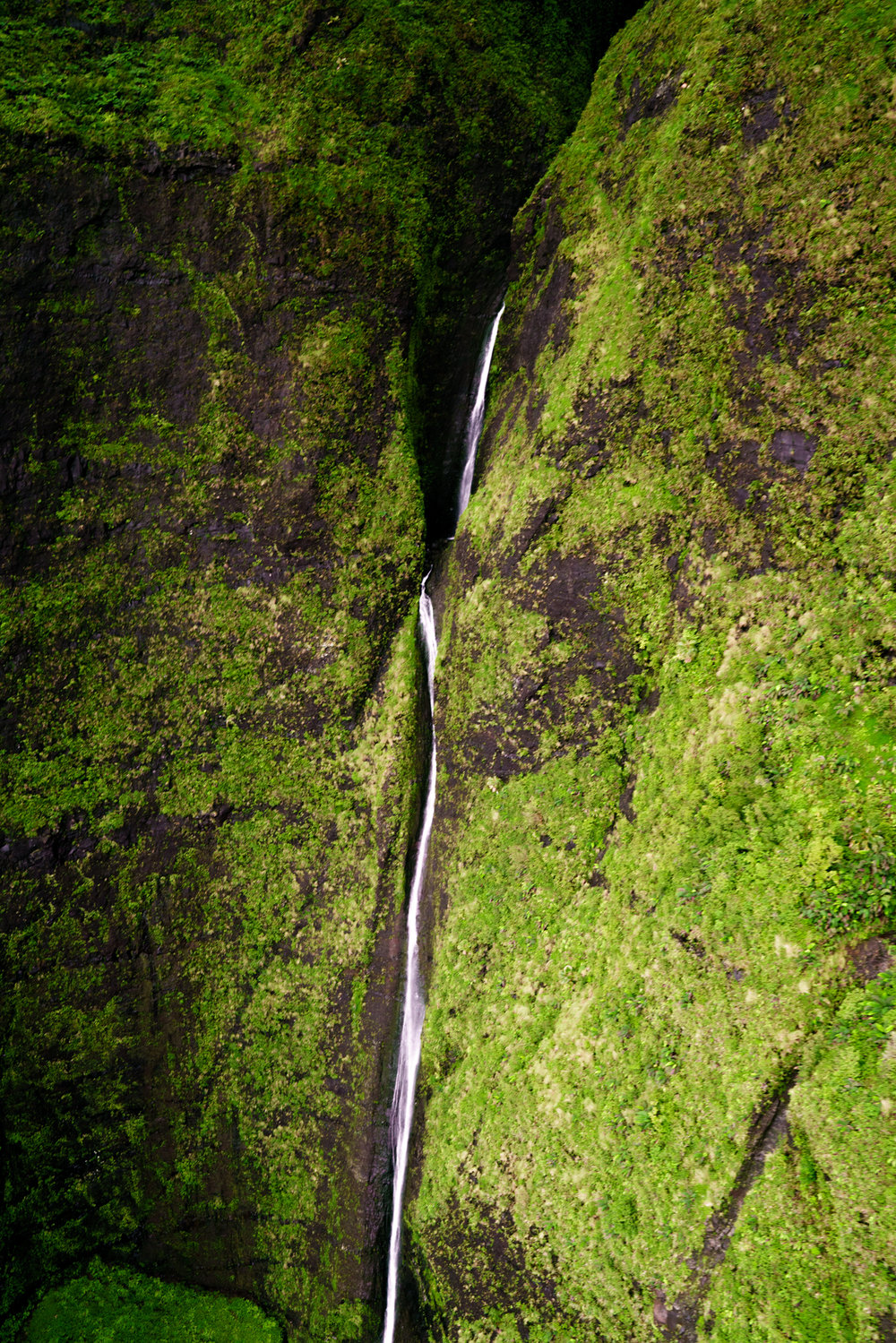 Chasing waterfalls along the Na Pali Coast in Kauai | Never Settle Travel