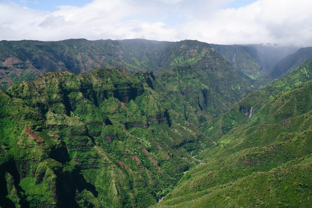 Entering Waimea Canyon with Mauna Loa Helicopter Tours | Never Settle Travel
