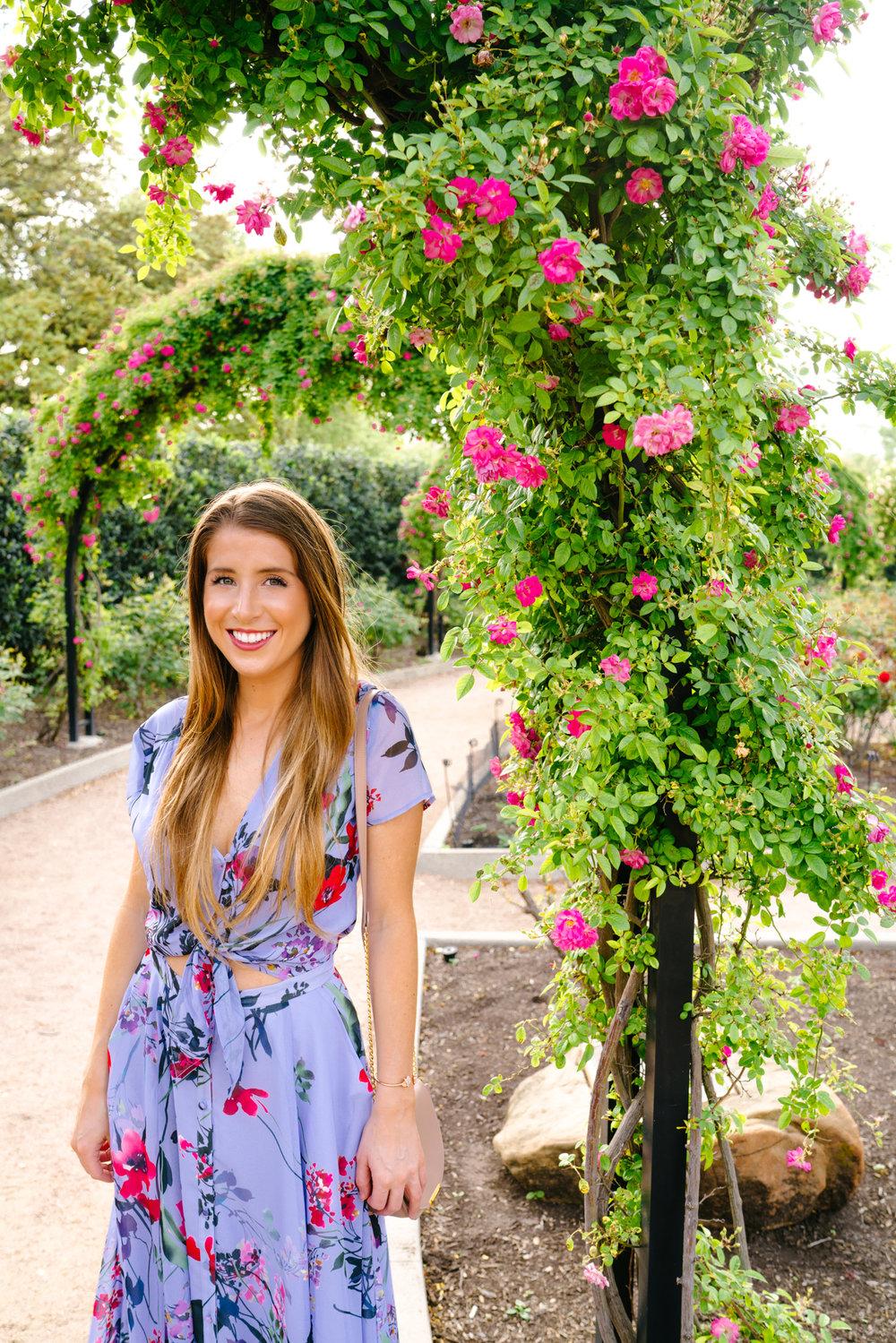 Wearing a floral Yumi Kim dress in the McGovern Centennial Rose Garden