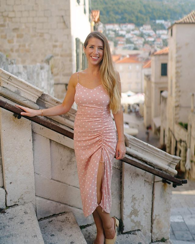 Welcome to King's Landing! Do you recognize where I'm standing? Swipe to see the famous GoT scene that was filmed right here.  I loved wandering through Old Town Dubrovnik in the early morning. By evening, music fills the squares and little restaurants open up in every nook and alley. My favorite was the sushi restaurant we stumbled upon 🍱  #croatiafulloflife #oldtown #dubrovnik #kingslanding #got #polkadots #pink #gltlove #dametraveler #femmetravel #darlingescapes #agameoftones #springbreak #happypiday #agameof5k #houstonblogger #styleblogger #liketkit #tbt #sheexplores #buildandbloom