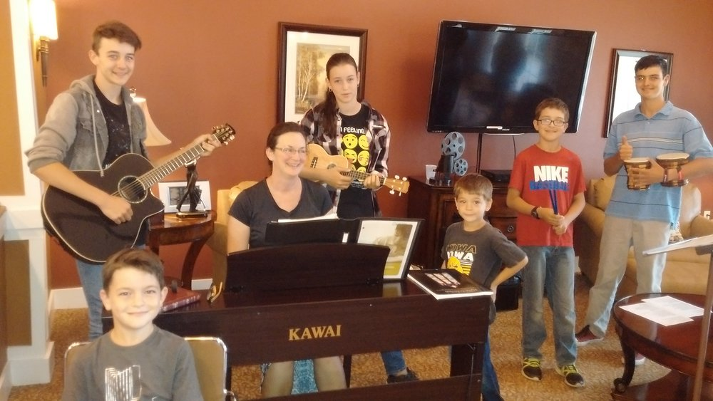Family sharing music at an Assisted Living facility in Denton, TX