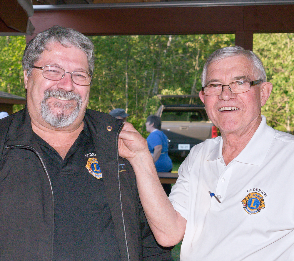 Incoming President  Lion Gary Blenkhorn  receiving his Presidents Pin from outgoing President Lion Bob Robson.