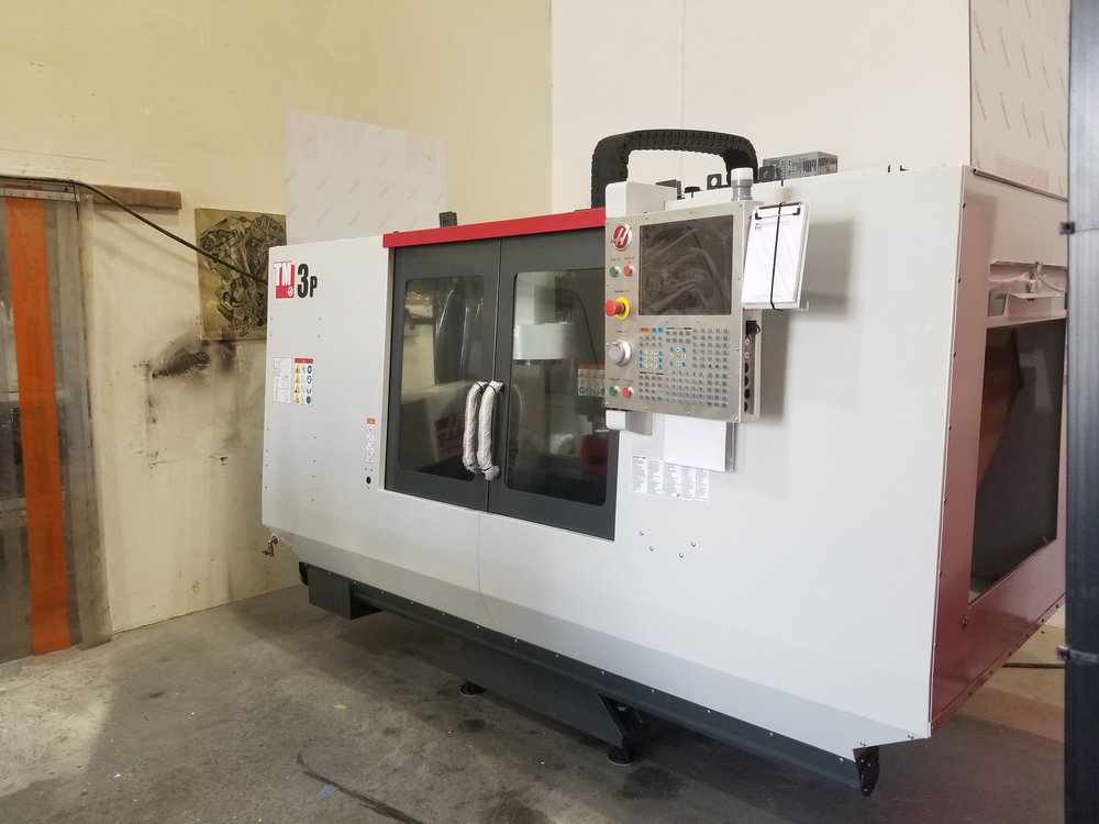 HAAS TM-3P - -3 axis ridged machining center, suitable for ferrous and non-ferrous metals and other various materials-40inx20inx16in enclosed working area-High accuracy and high speed machining-Renishaw probing system for set-up, in-machine quality control, and inspection