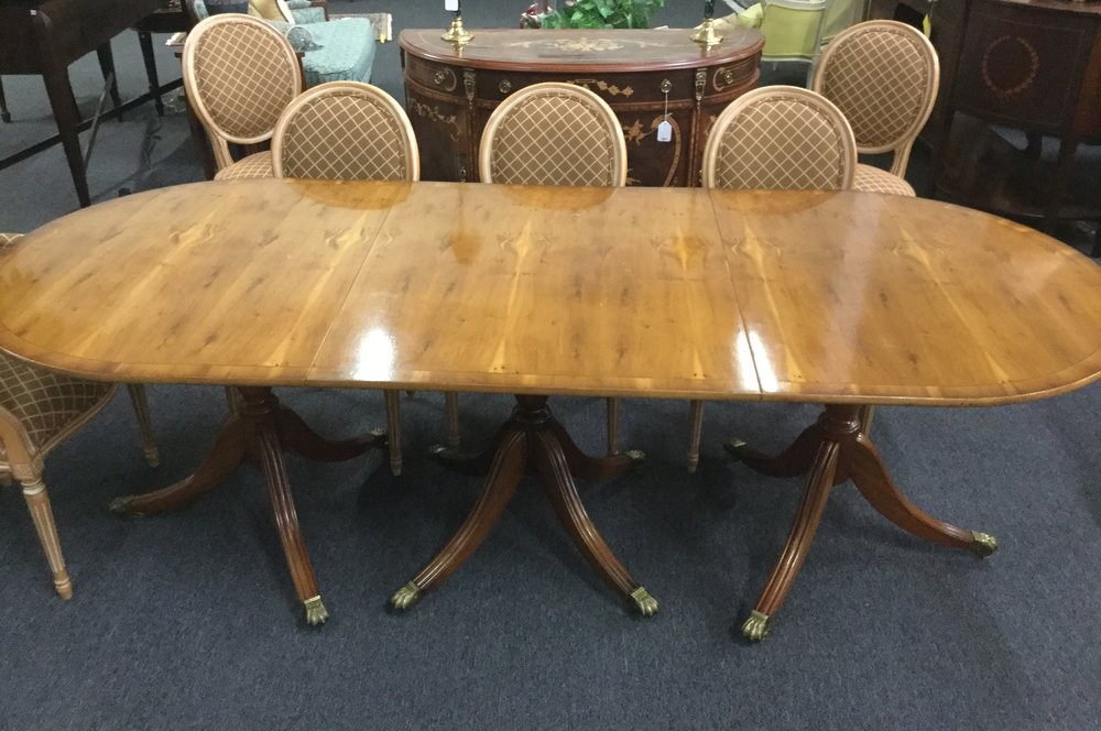 Yew wood triple pedestal dining table