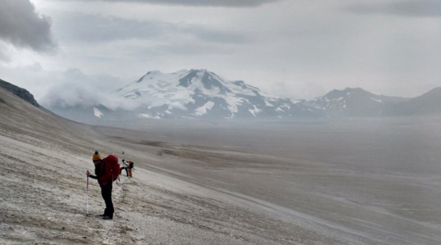 """Our cultural resource staff hiking back to camp from the base of Mount Cerberus. This was one of our projects where we re-located and documented one of the first NGS expedition camps."""