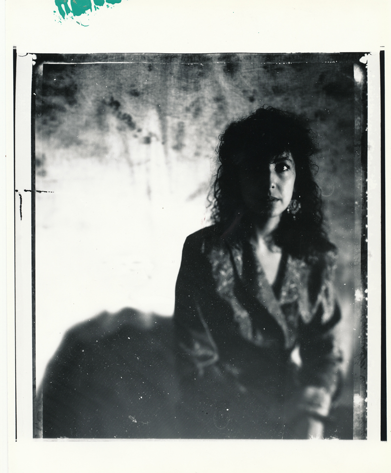 Laurie Seated   Contact print off 4x5 Polaroid test negative..  © Jud Burgess  1988