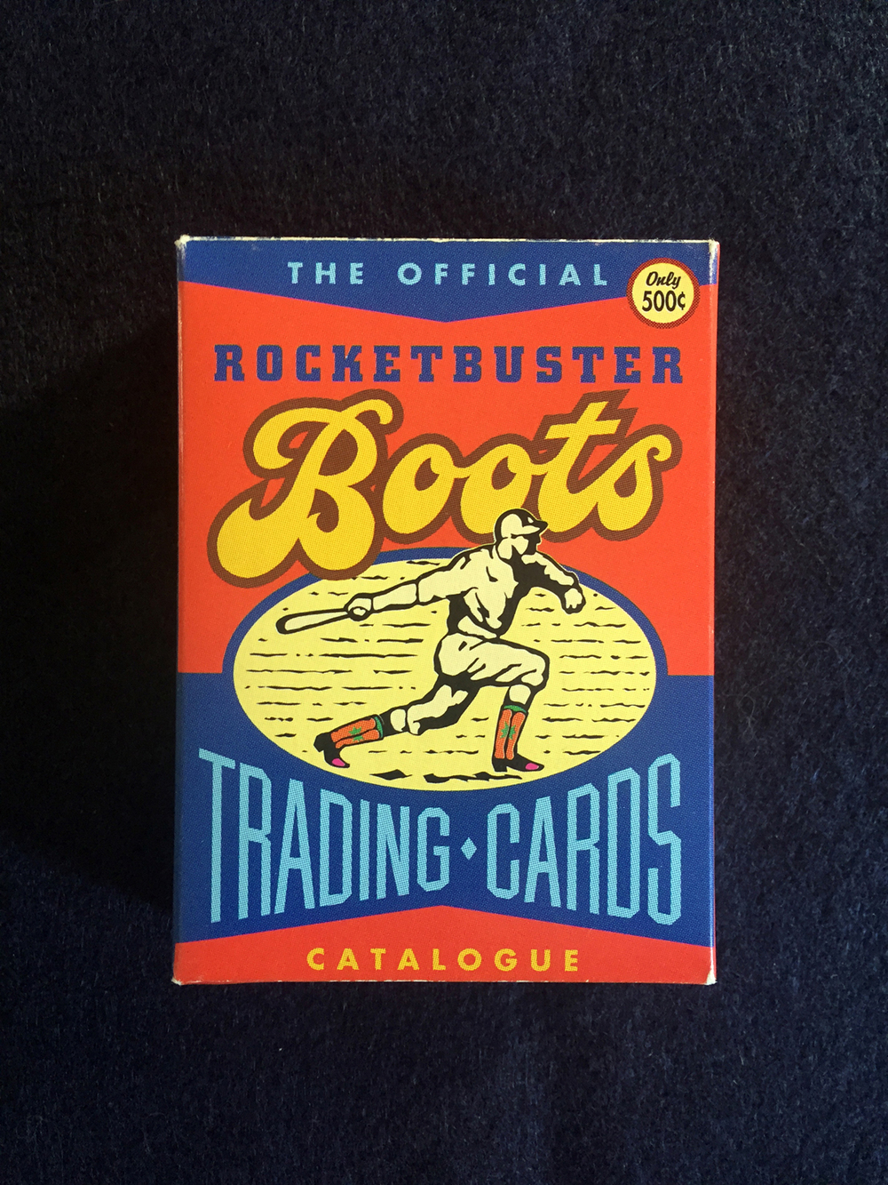 "I designed the ""Boots"" type in Illustrator, manipulated an existing font for the ""Trading Cards"", and illustrated a baseball player wearing his Rocketbusters.  Typographic heavy design."
