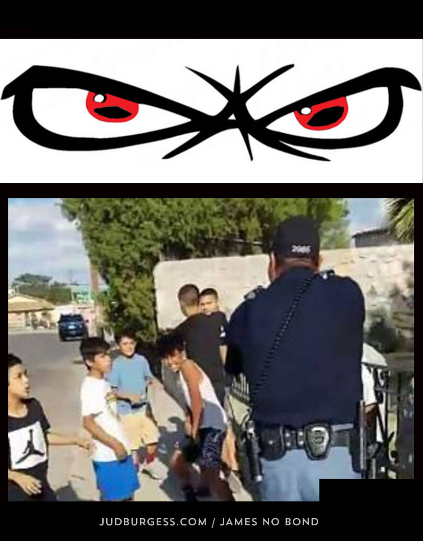 El Paso Cop Points Gun At Children © Jud Burgess