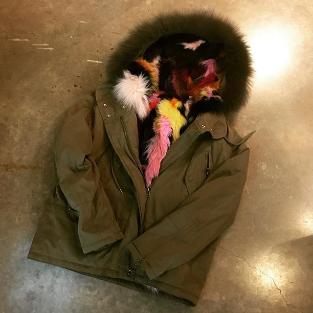 The most wanted bomber of the season!  Inside multi colored fox fur zips out to become a hooded vest!  It's the real deal! $595.