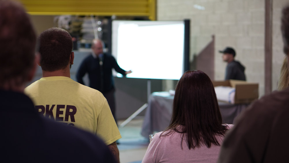 President Bill Parker Jr. leading a demonstration of Associate's Warehousing Management System at their open house last month.