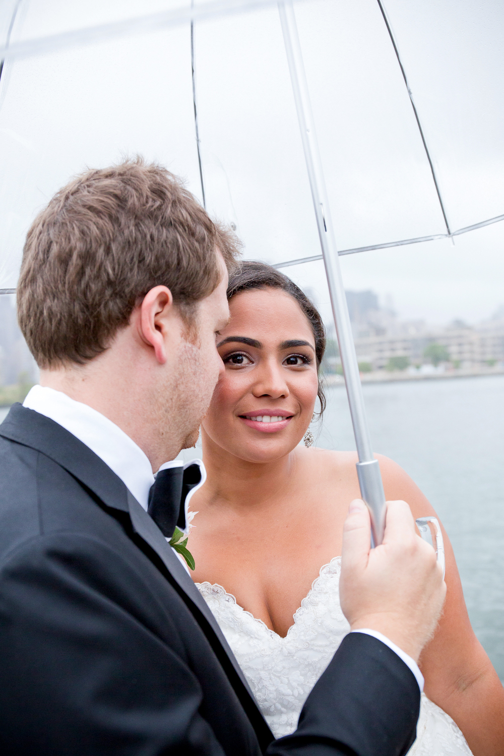 141_CarlyGaebe_SteadfastStudio_WeddingPhotography_NewYork_LongIslandCity_WatersEdge_EastRiver_Rainy_Umbrella_Bride_Groom.jpg