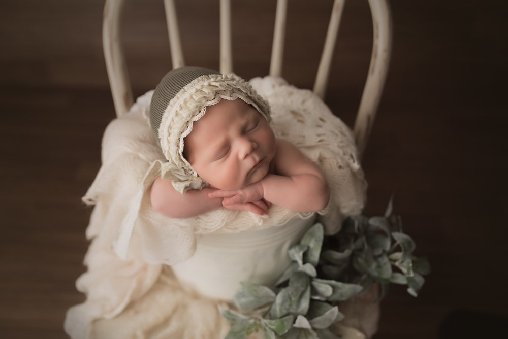 baby girl, rustic bonnet, hands on chin bucket pose