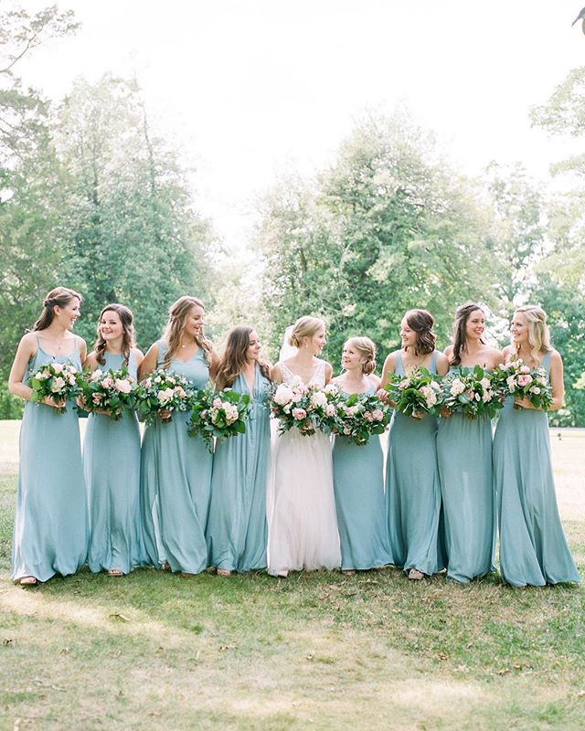 Bridesmaids in dusty blue and the bride in a beautiful @bhldn gown? Yes please! 😍 Photo by @lissa_ryan