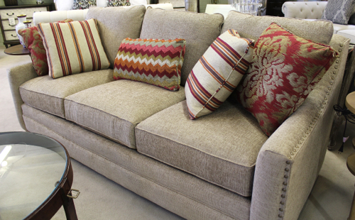 Brass nail heads trim this Craftmaster sofa