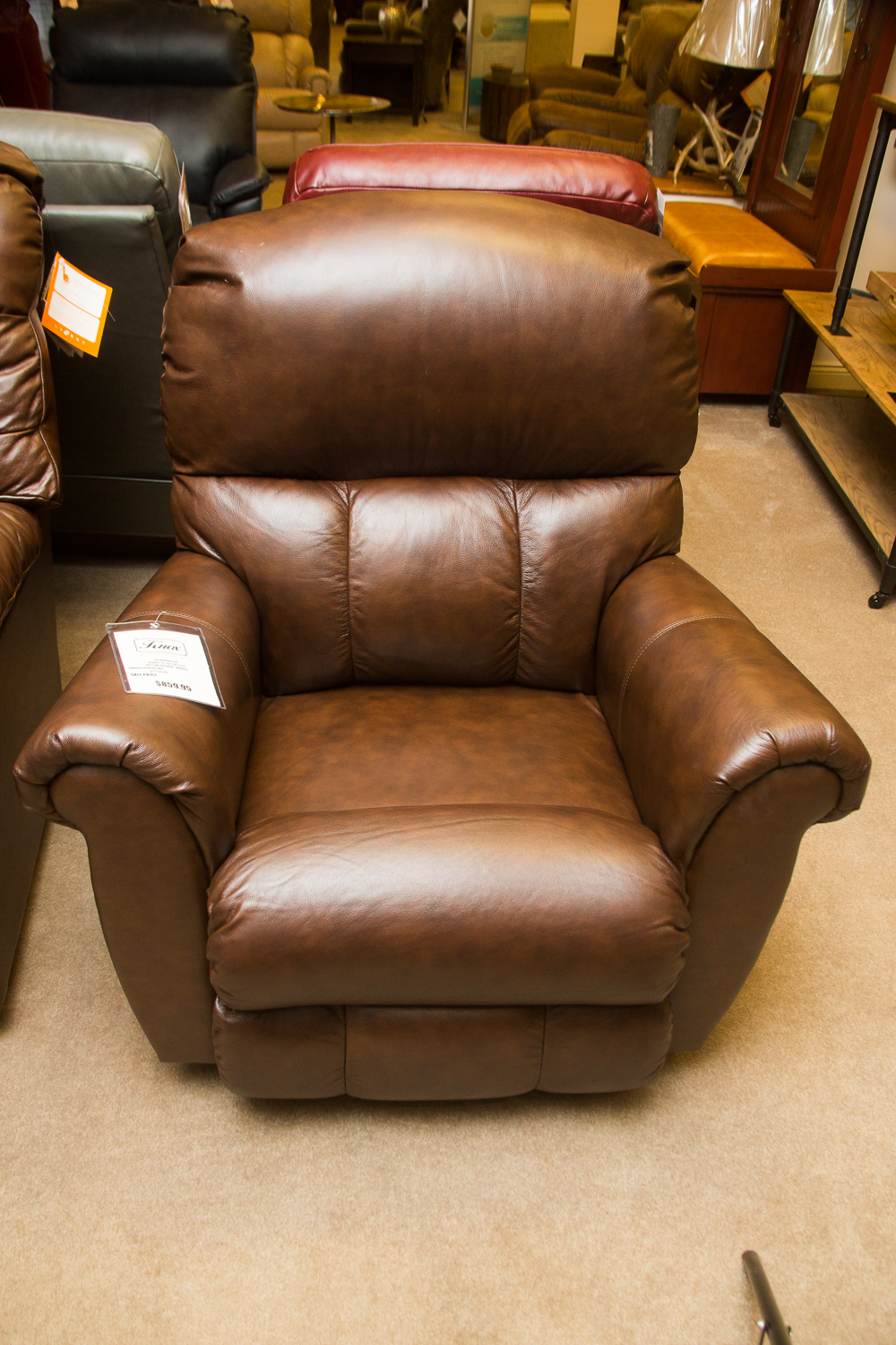 """Briggs"" Lazboy Chair shown in brown leather"