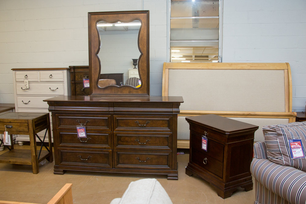 egacy Classics Dresser/Mirror/Nightstand. Headboard and Footboard in back ground is a King.