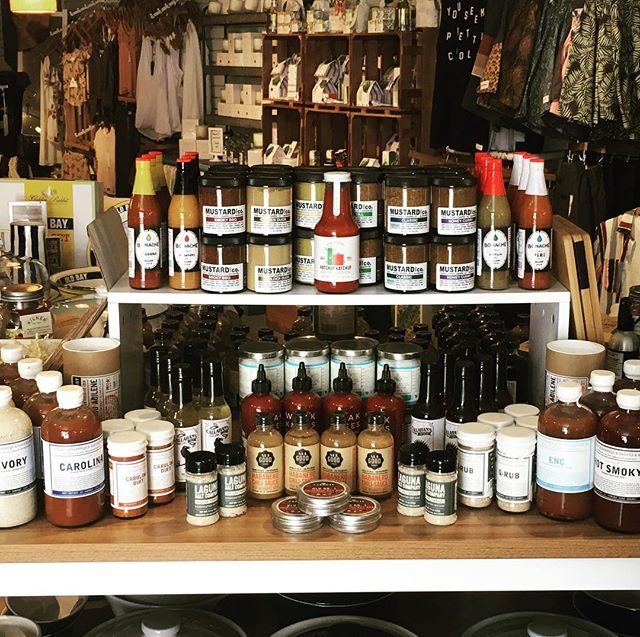 Fourth of July and BBQs are a match made in heaven and we have everything you need to wow your guests from BBQ rubs to sauces, hot sauces, flavored salts and even salad dressing so you can have your veggies too. #cookout #fourthofjuly #bbq #hotsauce #toomuchsauce #bethanybeachde