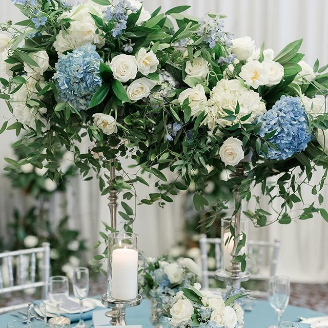 "Last but certainly not least, Something Blue!  The traditional of wearing or carrying ""something blue"" represents love, purity and fidelity—three key qualities for a solid marriage.  But you don't have to wear blue, you can incorporate it into your decor!  Beyond beautiful!  Florist and lead designer: @kpdesignsmadison  Linens, dinnerware, and rentals: @eventessentialsmadison  Stationery:  @thecraftypeach  Cake:  @creativeconfectionsbyalicia  Favor: @gailambrosiuschocolatier 📷 by @maisonmeredith"