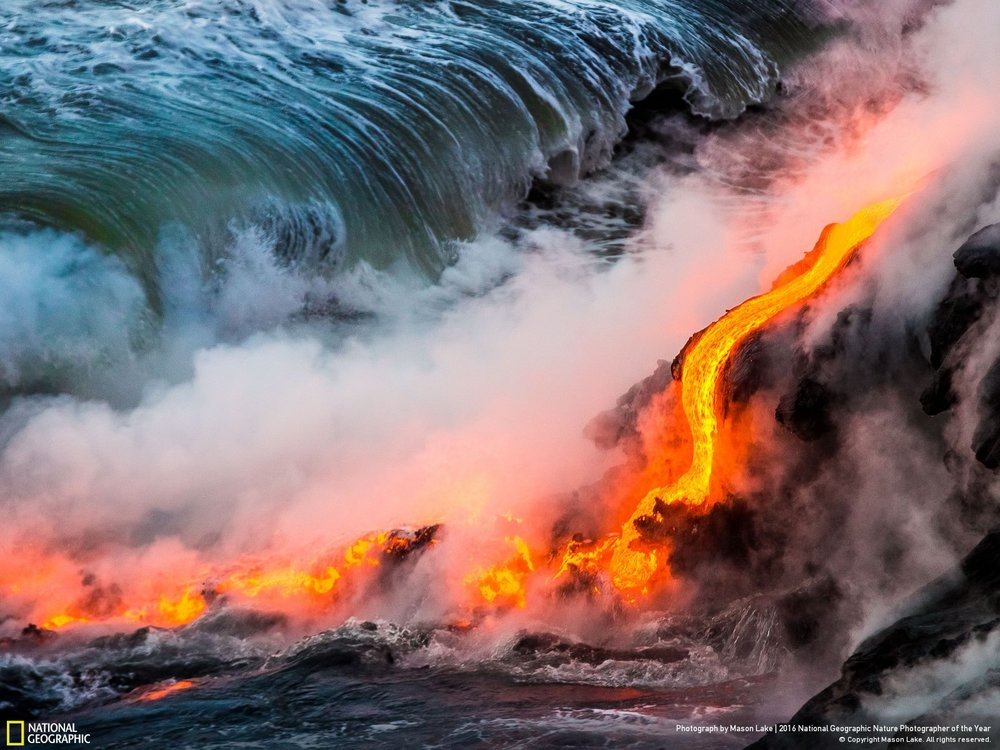 Lava Ocean Entry by Mason Lake: Lava ocean entry from the 2016 Kalapana lava flow on the Big Island of Hawaii. Watching new earth being formed is an amazing experience. Boiling ocean waves crashing into fresh lava & giving off clouds of steam along with scatter violent lava bursts from pressure release, creation of the earth is mesmerizing & powerful sight. Location: Hawaii
