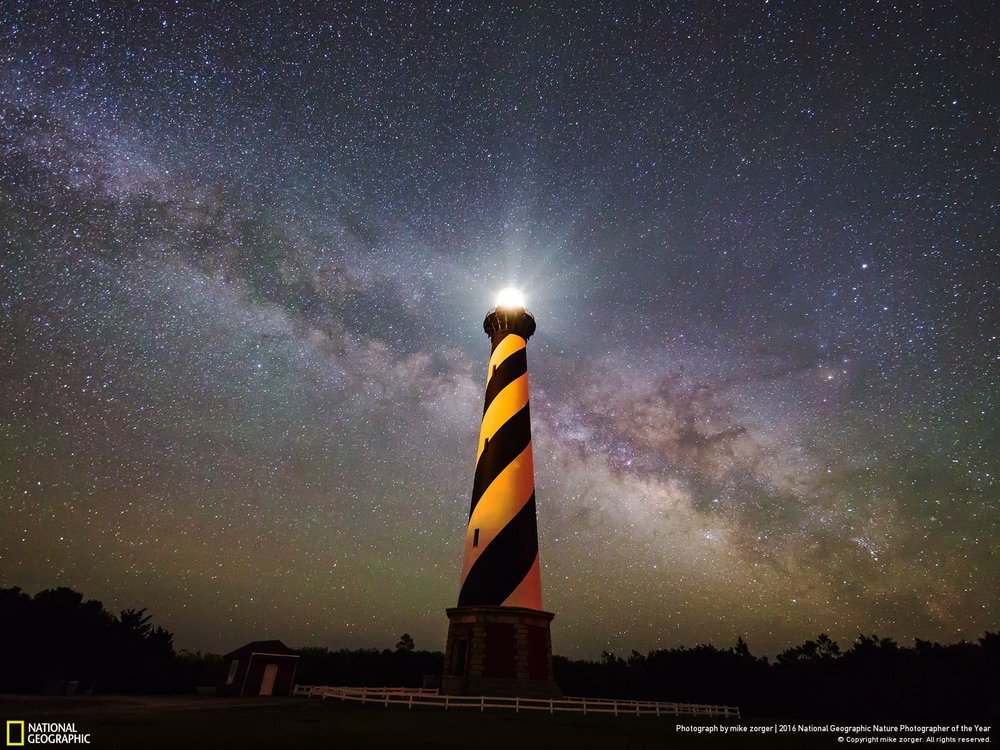Lighting Up the Galaxy by Mike Zorger: This is a time-lapse frame taken at the Cape Hatteras Lighthouse. This angle possibly has the least light pollution of any spot on the East Coast which allows the camera to capture the most possible detail. My most recent set of goals are to show off the few extremely dark skies on the East Coast. Not many know about them and most think you need to go to the western states to see the Milky Way.