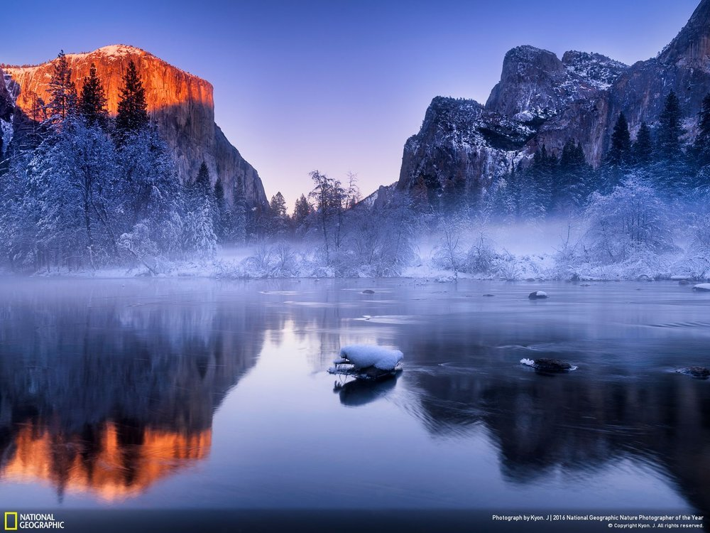 Light of Hope by Kyon J.: I spent my new-year-holiday in Yosemite Valley and cheered for the new year there!! I had been waiting and expecting for such a kind of sunlight coming down the mountain top and turning red gradually before sunset. Luckily I finally got this magical light, which to me, meant to the Light of Hope, celebrating the brand new 2016! Location: United States