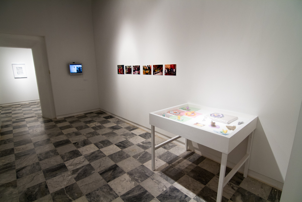 Left: 'Falling', performance  video  documentation.  Right: 'Giving, an art action', performance memorabilia and photographic documentation.