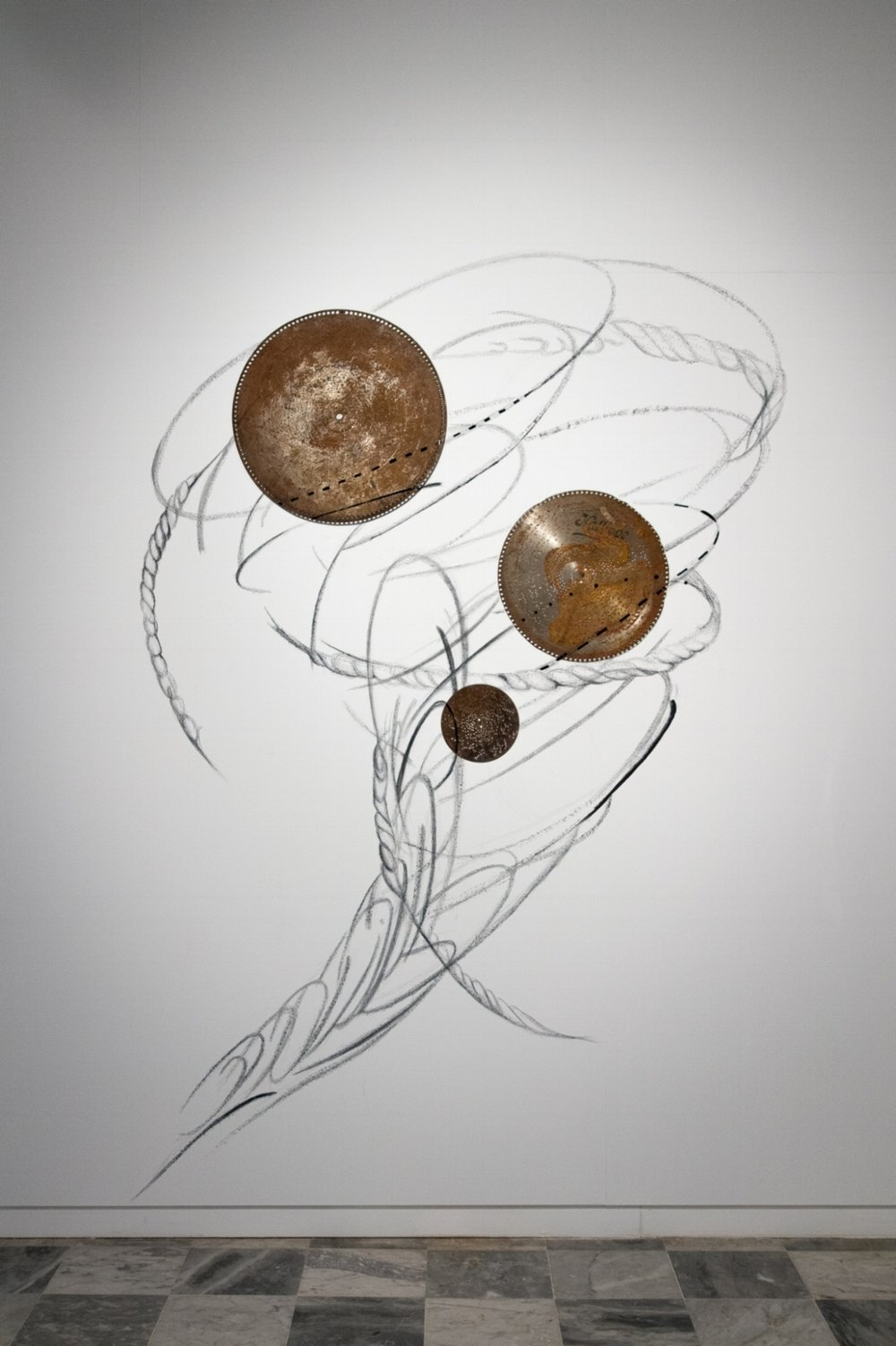 'Rabo de nube' (Waterspout)  Wall drawing. Graphite, tape, corroded symphonium discs.