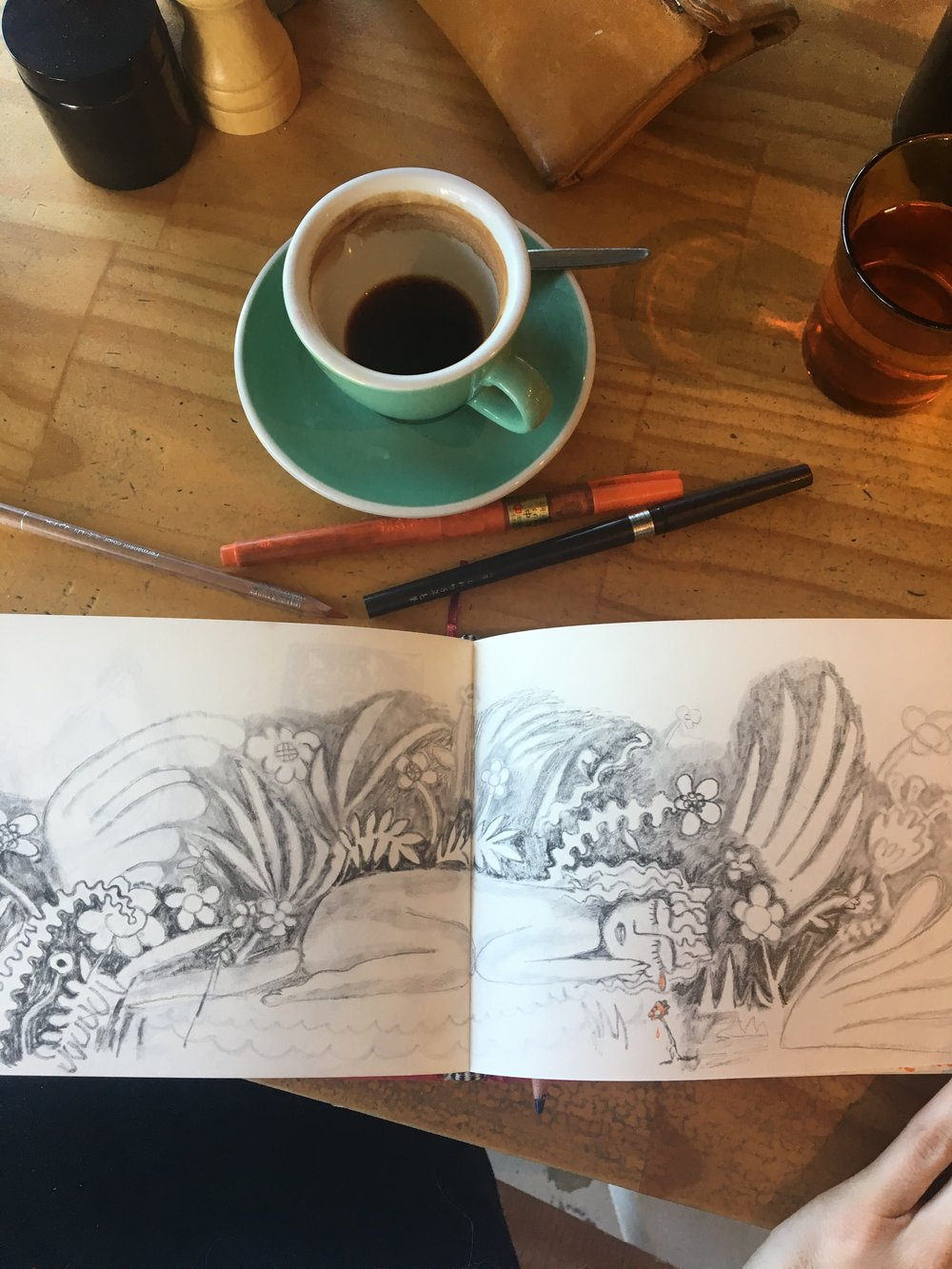 Sketchbook process, coffee and messy pens.